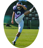 football player kicking football