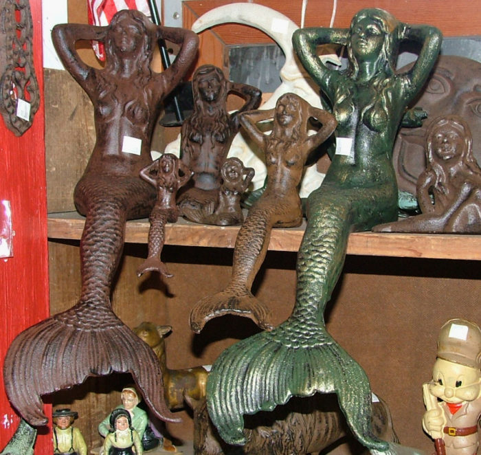 Diverse collection of cast iron mermaids at Bahoukas!