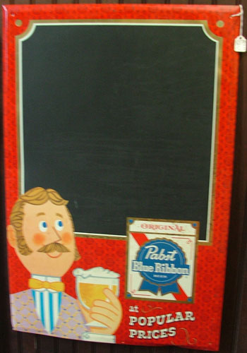 An advertising piece for Pabst used as a chalkboard to write specials/menu items.