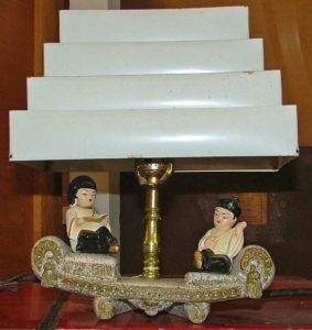 Oriental couple lounge on sofa of TV lamp - Bahoukas Antique Mall
