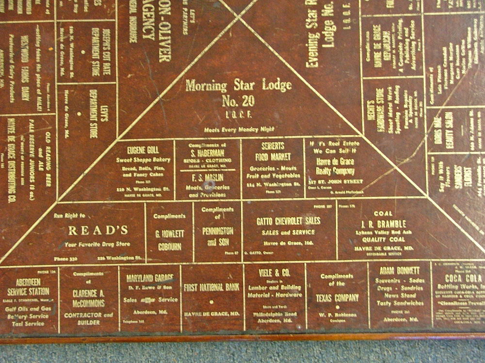 Section 1 of 1940s Advertising on a card table at Bahoukas in Havre de Grace