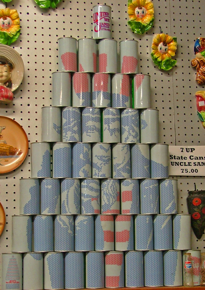 7-up can collection makes a picture of Uncle Sam - 50 cans - one representing each state in the U.S.