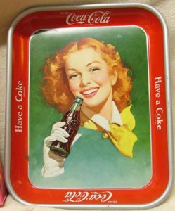 1950 Coca Cola advertising tray with a red-headed lady drinking a Coke