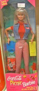 Special Edition Coca Cola Barbie Doll still in box, 1997, Red top, denim vest, red and white checked slacks with various Coca Cola items
