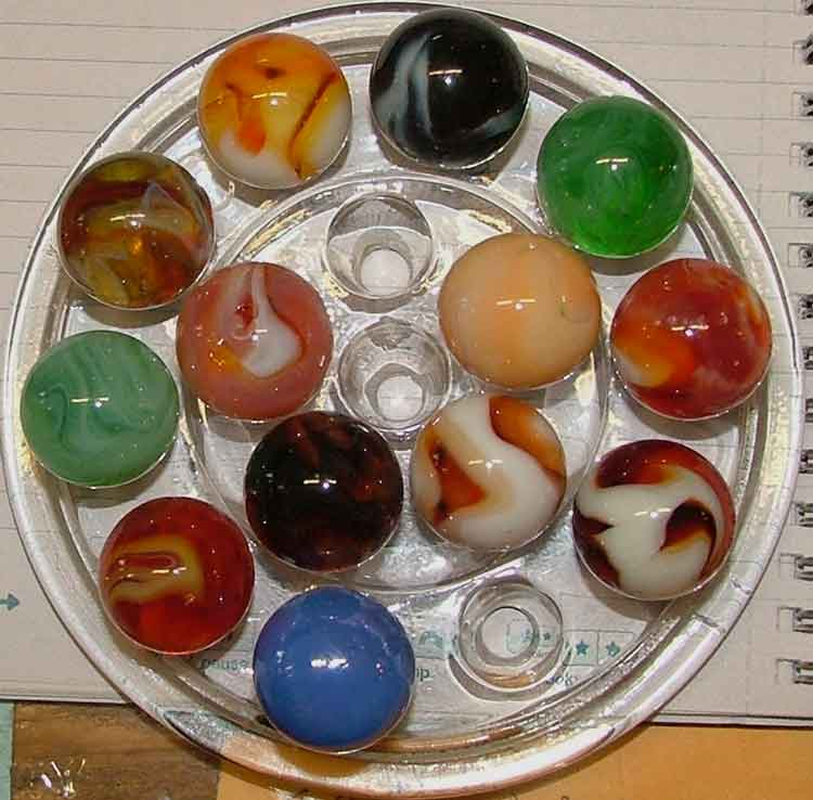 Round dish of shooter marbles at Bahoukas in Havre de Grace