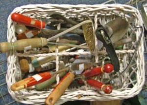 a variety of vintage kitchen utensils in a basket available at Bahoukas