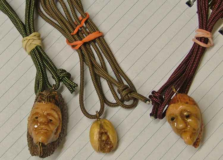 """Crazy NUtz"" - jewelry carved from Brazil Nuts, Almonds or Pistachios by Robert Davis from Kansas available at Bahoukas Antiques in Maryland"