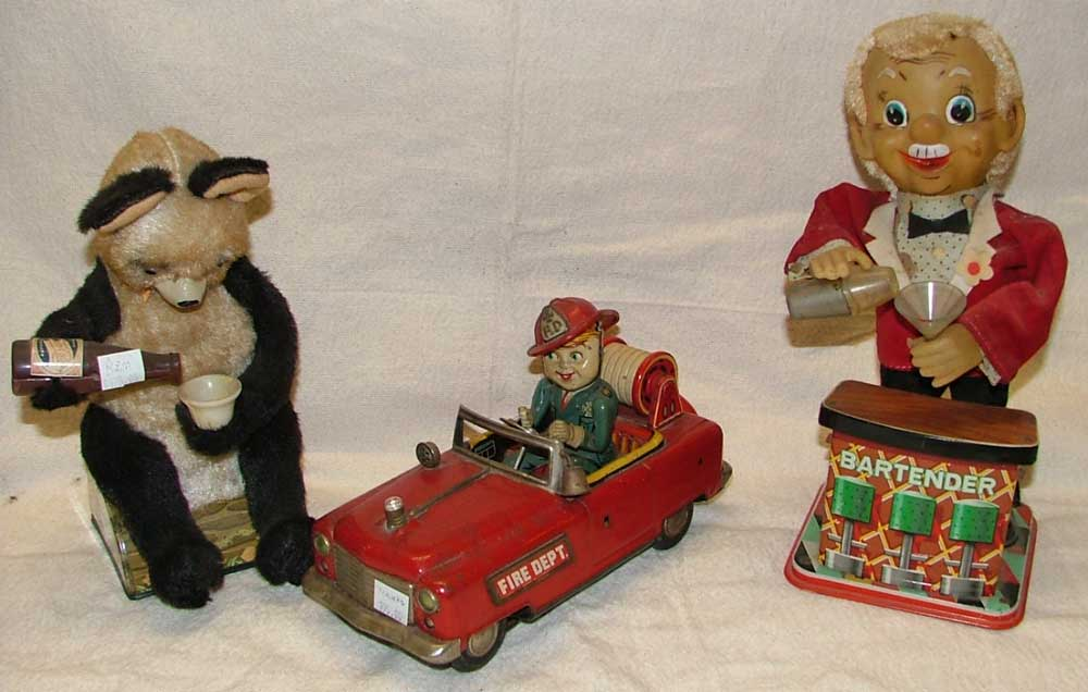 Battery Operated 1950s Japanese Toys includes a bear, a firetruck and a bartender all available at Bahoukas in Havre de Grace, Maryland