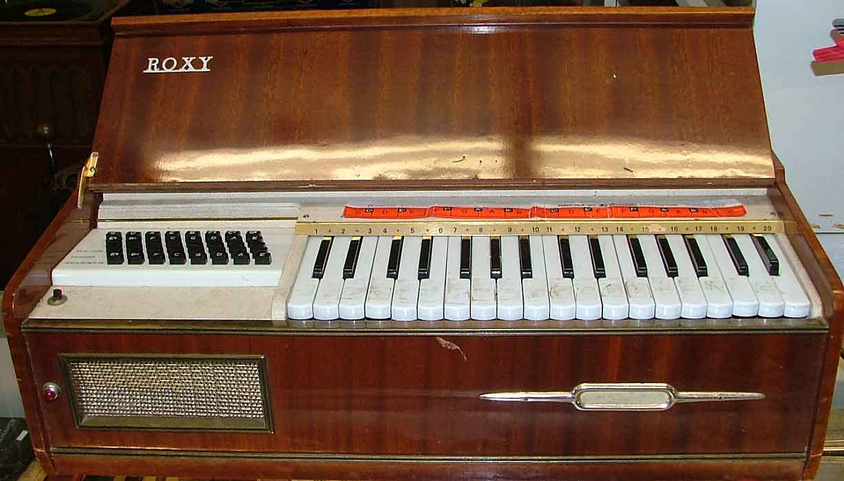 Roxy Chord Organ 1960s and still plays available at Bahoukas Antiques Havre de Grace, MD