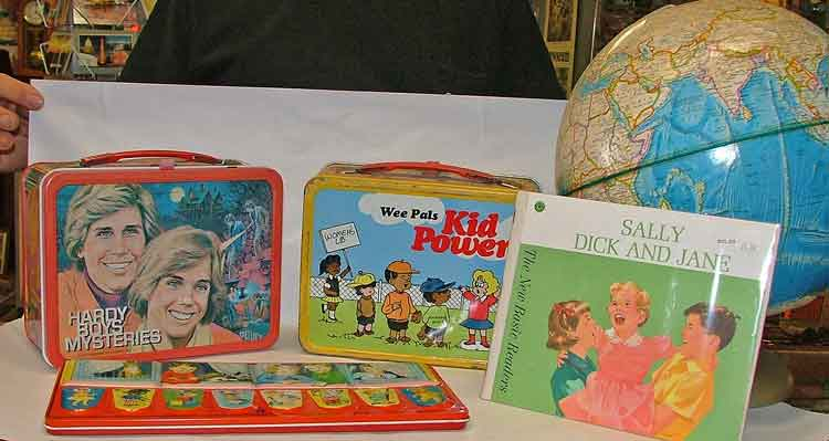 collectible character lunch boxes, Dick and Jane Reader, world globe and a beautiful palette of watercolor paints are just a few of the back-to-school items available at Bahoukas Antiques.