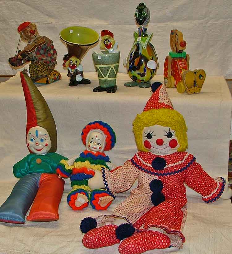 Back row: L-R clown playing violin, blown glass L-R Kinckerbocker stuffed clown, 2 other stuffed clowns, Czechoslovakian blown glass clowns, Sqeaky the clown pull toy