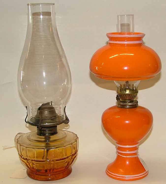 oil - kerosene lamps for home use - one with clear globe - one in orange