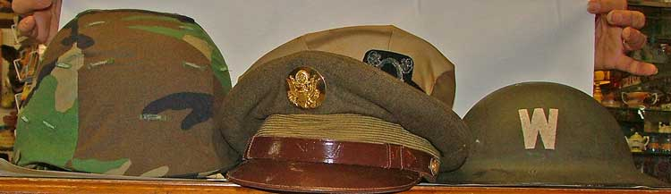 military hats - l to r - Kevlar, Army, Navy visor caps, WWI cap