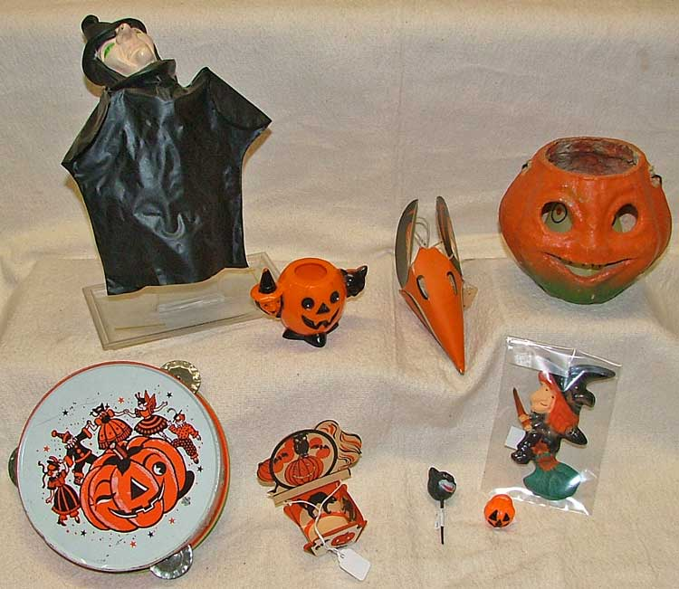 Halloween party items - witch puppet (plastic), pumpkin, favors, small pumpkin for candle, tamborine, and various small items for cake decorating, etc.