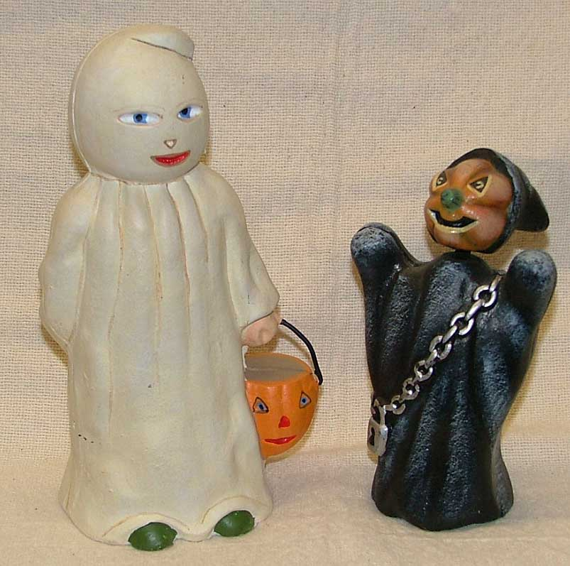 Cast Iron Halloween collectibles - ghost on leftl, witch ghost on right