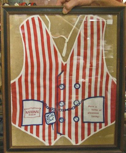 Natty Boh red-white striped apron in frame
