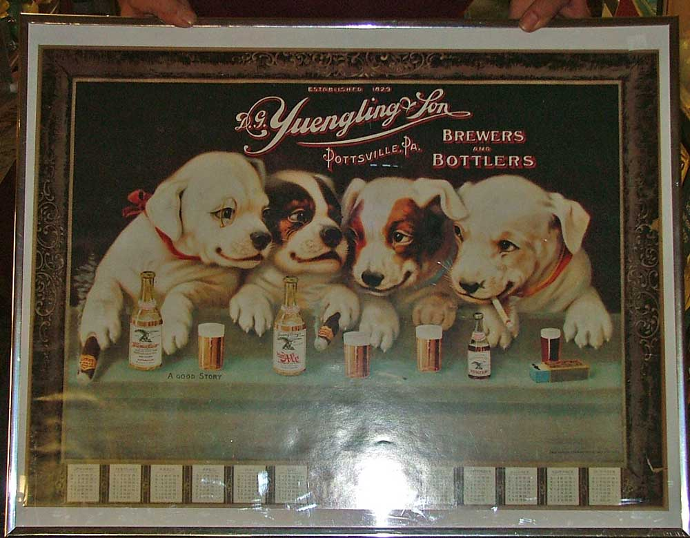 Yuengling reproduction of 1907 calendar poster with puppies on it