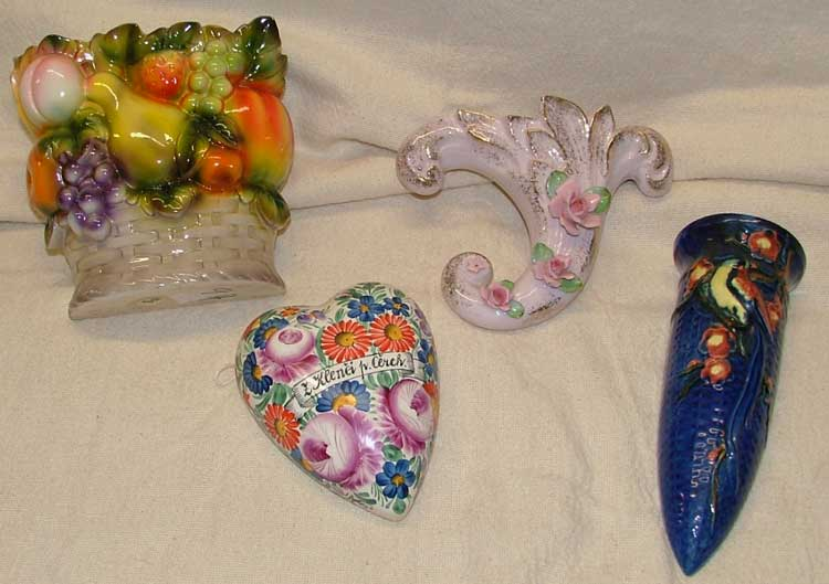 These delightful wall pockets include a fruit basket, cornucopia covered in rosebuds, Czechoslovakian heart shaped covered in flowers and a deep blue tube with design