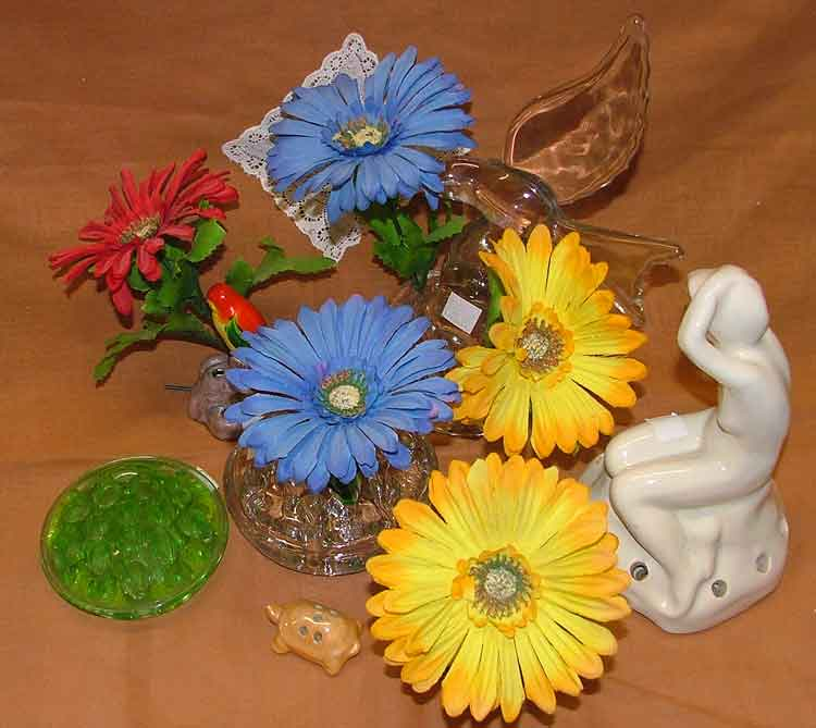 Various flower holders, some include sculpture or a candle holder