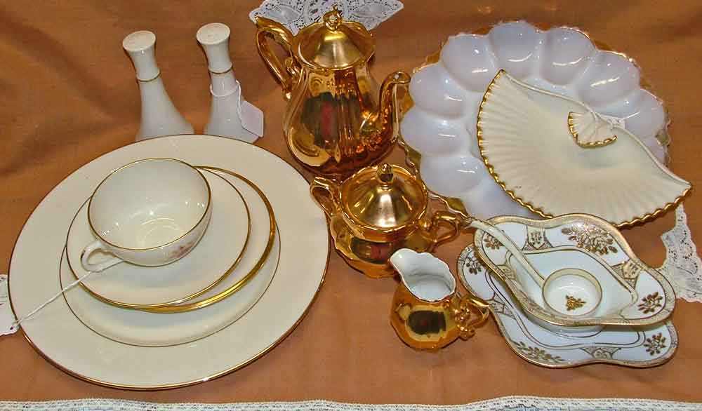 Beautiful white and gold place setting, tea set for the holidays