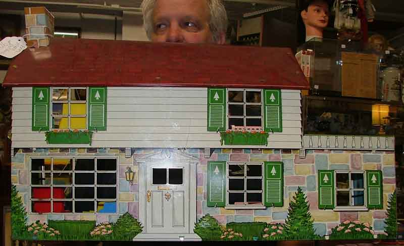 the outside view of this metal doll house at Bahoukas Antiques