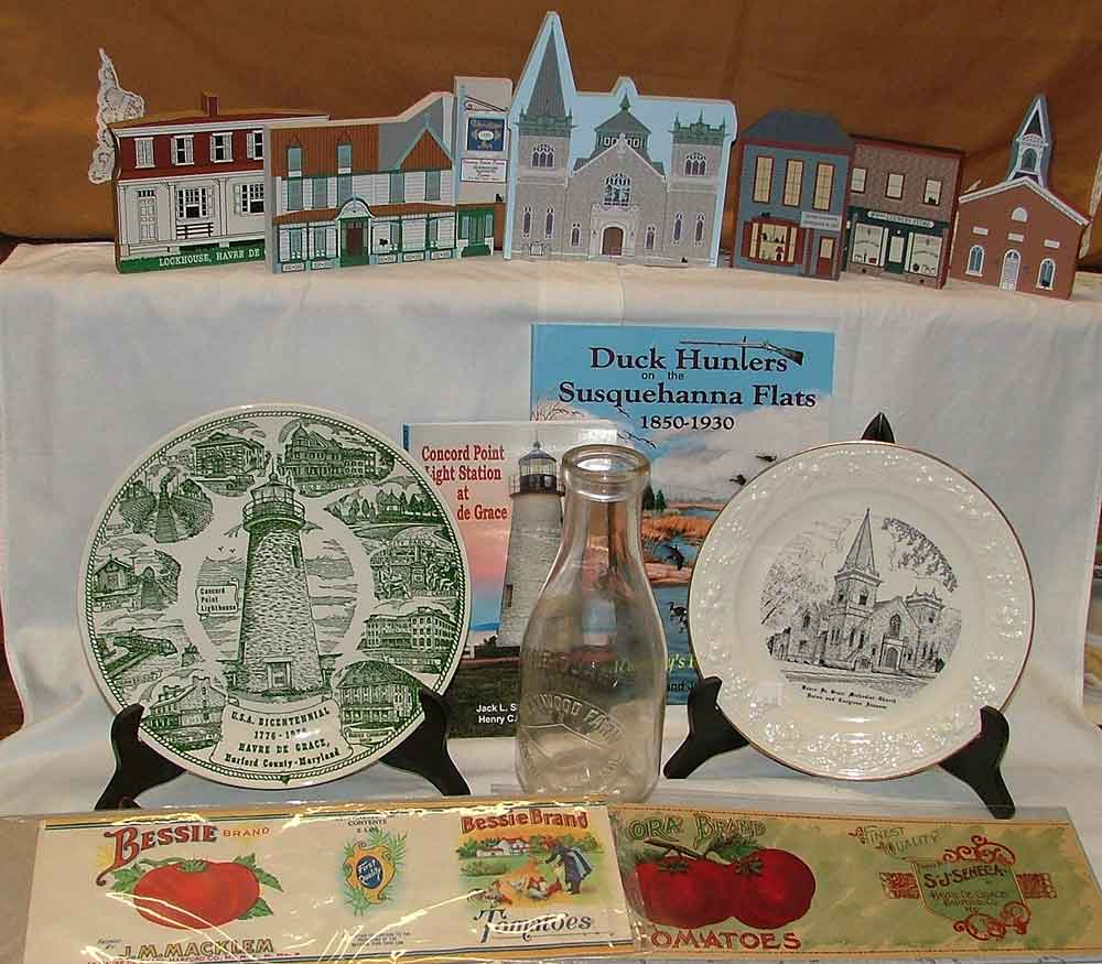 Havre de Grace Memorabilia including Westwood Farm milk bottle, labels for Taylor at Seneca or JM Macklem (tomatoes), 2 books, 2 commemorative plates, B&S brand shortening tin, etc.