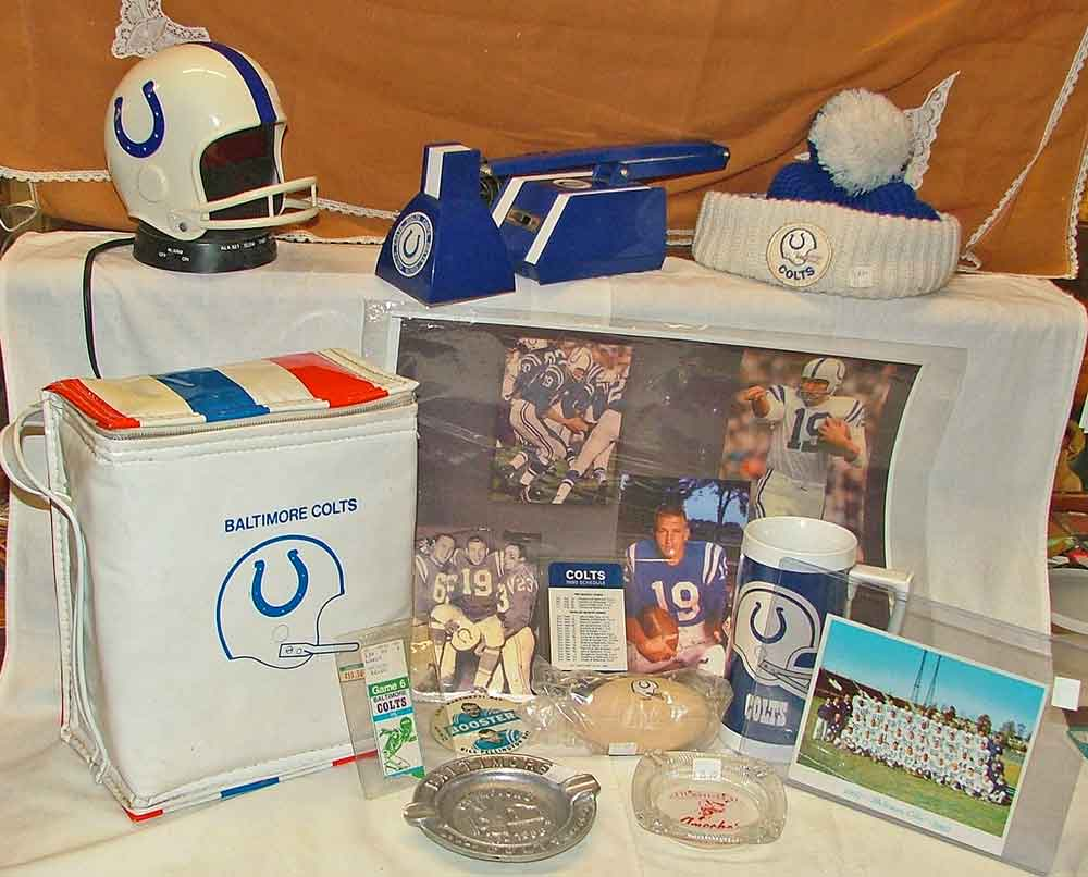 Baltimore Colts Memorabilia includes helmet clock, desk lamp, hat, 2-thermos insulated bag, Johnny Unitas signed photo, 1960s Christmas card, 1982 ticket stub, booster pin, 1980 schedule, beer mug, NFL Champions 1958, Ameche's ash tay w/Colt's logo all available at Bahoukas