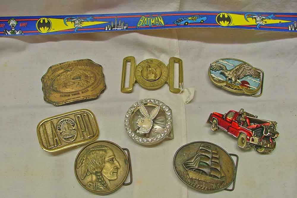 Belt Buckles that include Southern Comfort, an Eagle, LAPD Police Dept, PlayBoy Bunny, Native American, Tall Ship, and a Wrecker Tow Truck plus a Batman Kid's Belt.