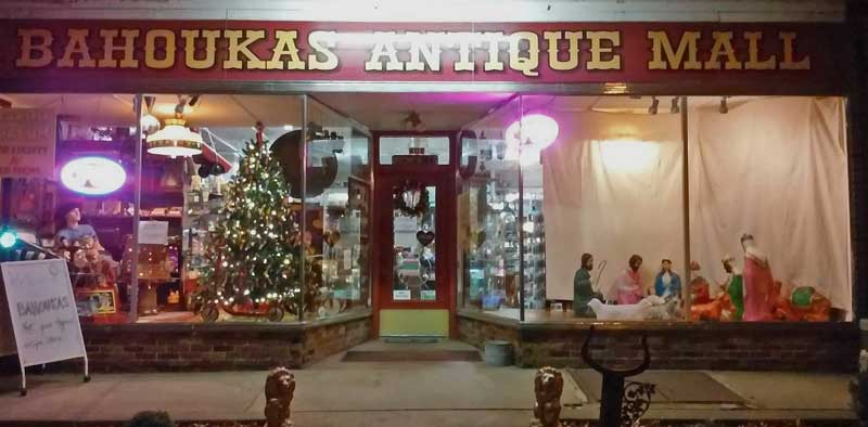 Bahoukas Antique Mall front window - Holiday Decorations with the famous PEZ Christmas Tree and the Nativity on the other side!