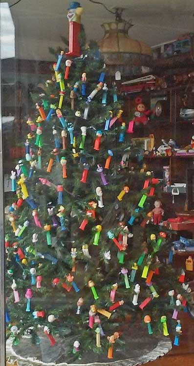 Christmas Tree decorated with PEZ Dispensers in window at Bahoukas Antique Mall in Havre de Grace