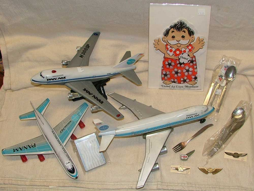 PanAm transistor radio plane, deck of cards, United Air Lines puppet, TWA pilot wings and more models