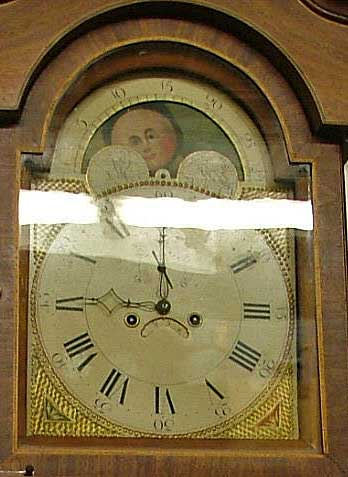 A closer view of the face of the grandfather clock