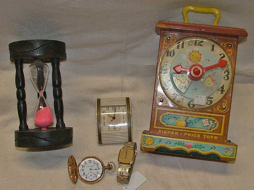 10 min 'hour glass' , Fisher Price clock, Burlington SPecial Pocket Watch, Coca Cola watch w/diamonds, and a travel alarm clock by Westclox