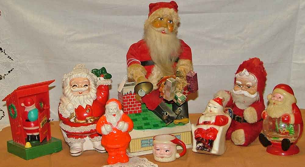 Fun choices of Santa collectibles at Bahoukas include 1970 Santa in the Outhouse, Spaghetti Santa ceramic bank, 60s battery operated animated Santa on roof top, stuffed Santa 1950s, Plastic Irwin Candy dispenser, 1960s Santa Mug, Rocking Chair Santa Candle and Santa Snow-Globe from the 1960s.