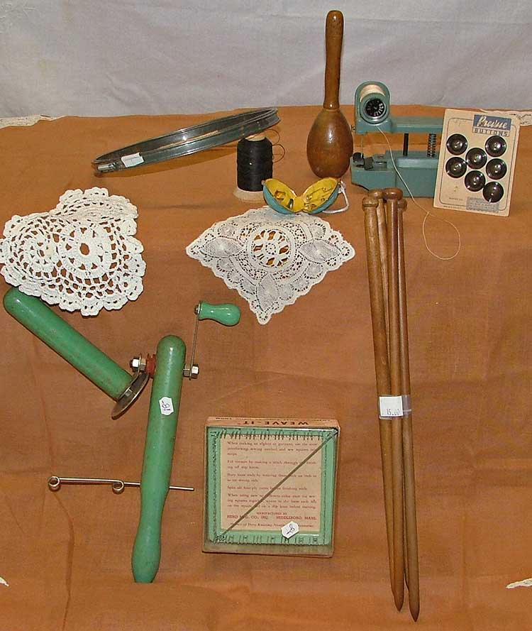 Crafty gifts at Bahoukas Antiques include embroidery hoops, sock darner, hand sewing mahcing, buttons, salknut sewing kit (1950s), tool to make a yarn ball, small weaving loom, wood knitting needles