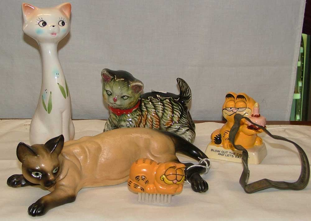 Cat figurines make for great stocking stuffers at Christmas from Bahoukas in Havre de Grace