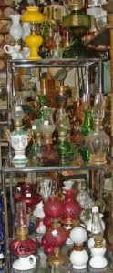 Green and other shades of oil lamps at Bahoukas Antiques in Havre de Grace