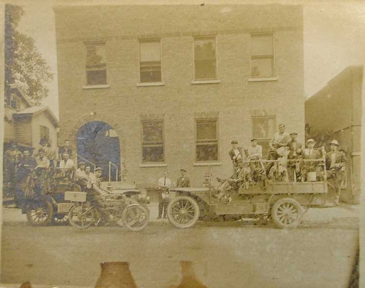 This old photo includes an early Harley Davidson