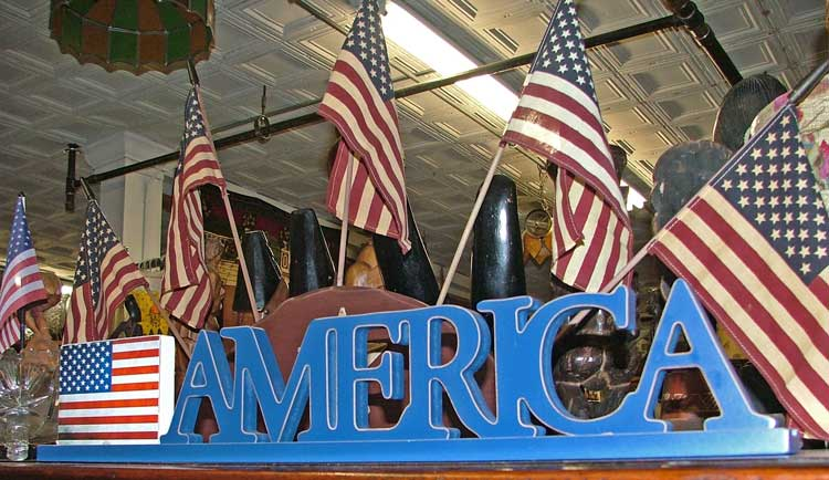 Flags, AMERICA sign, and more Military items at Bahoukas in Havre de Grace