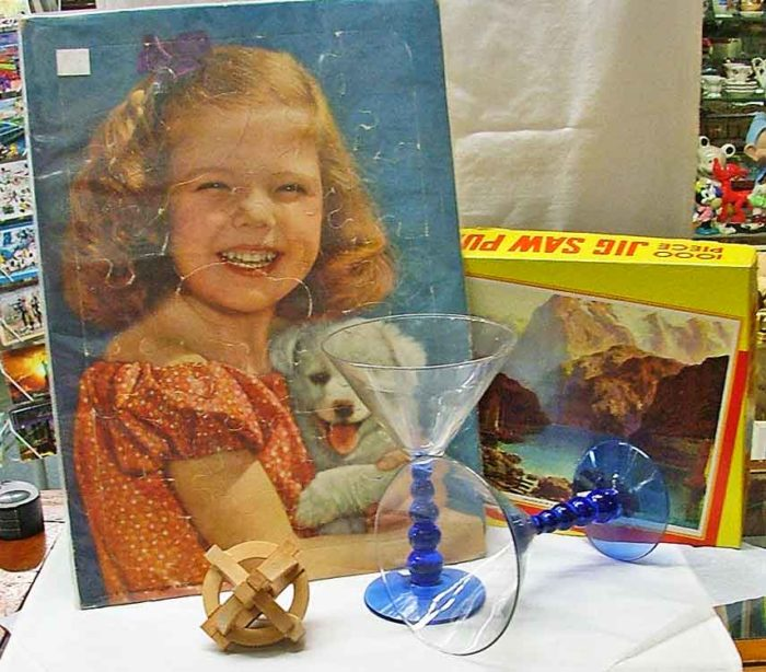 July is Anti-Boredom Month and Bahoukas has some solutions, including a picture puzzle and wooden puzzles.