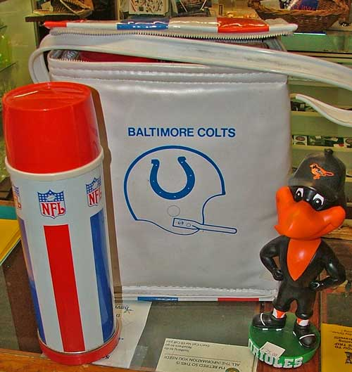 collectible Baltimore Colts thermos carrier and a B-more Orioles Bird at Bahoukas