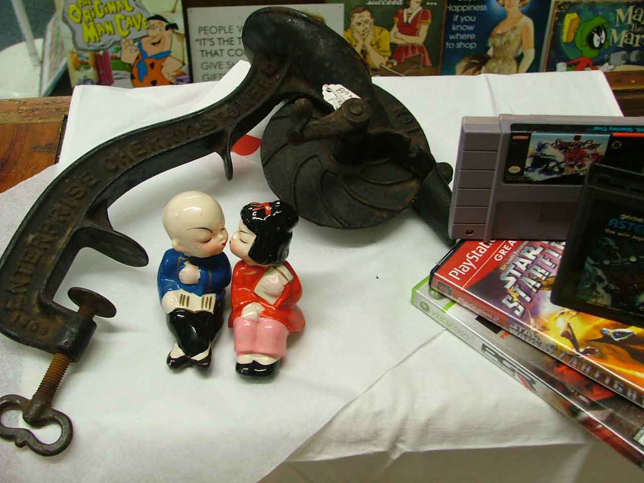 Kissing figurines, cherry pitter, and video games - make for some fun treasures at Bahoukas Antiques