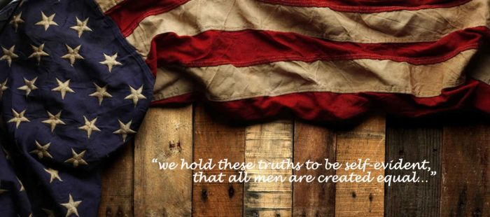 """American flag with """"We hold these truths to be self-evident, that all men are created equal"""""""