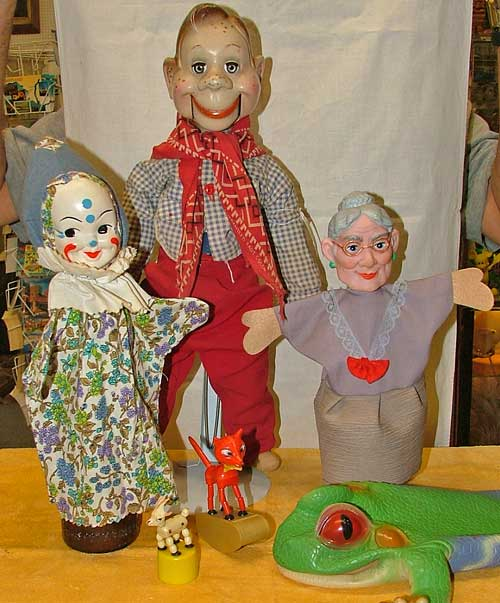 Puppets at Bahoukas in Havre de Grace include Howdy Doody, cloth hand puppet with plastic clown face, lady hand puppet, plastic frog hand puppet, and goat and fox push puppets