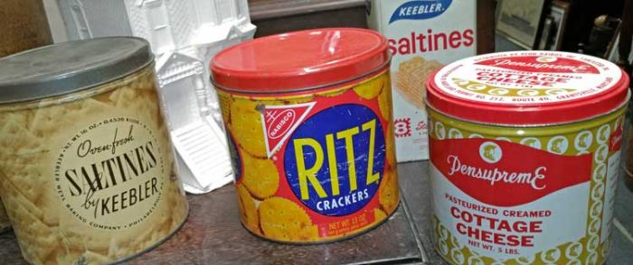 a selction of  tin cans with advertising, Saltines by Keebler, Ritz Crackers, Pensupreme Cottage Cheese