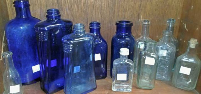 Shades of blue and clear glass bottles - beautiful on a window sill - Bahoukas in Havre de Grace