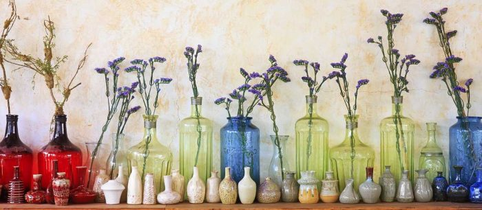 The whimsy of summer flowers in a variety of collectble, colored jars at Bahoukas in Havre de Grace