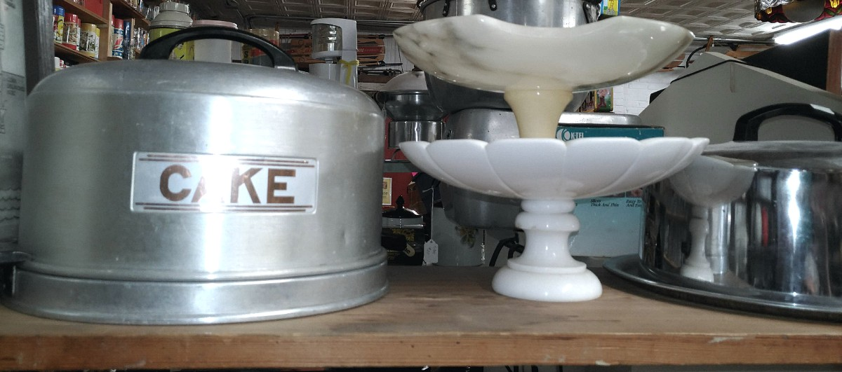 Cake carrier and serving dishes at Bahoukas Antique Mall