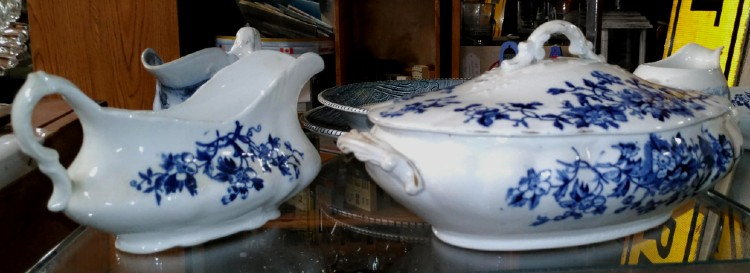 blue and white gravy boat and covered serving dish at Bahoukas