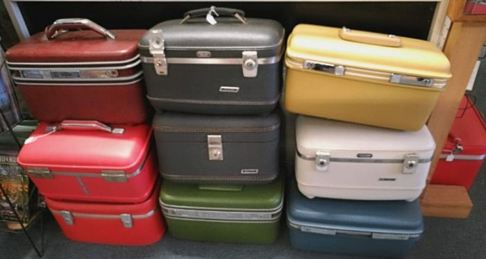 Beautiful and colorful assortment of train cases available at Bahoukas in Havre de Grace.